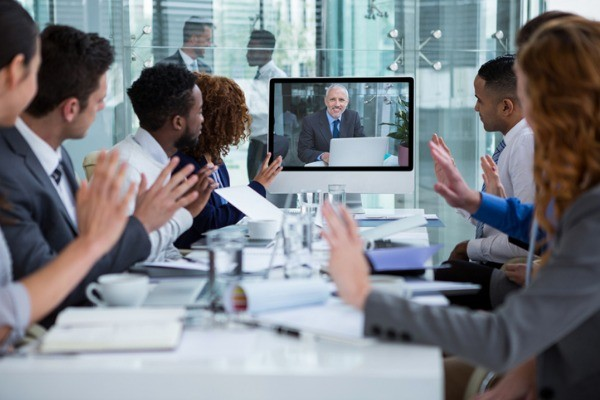 business people looking at a screen during a video conference picture id649881380 - Phone Systems